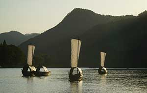 Boats with sails on a Chinese river